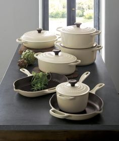 In a fresh cream color you\'ll find only at Crate and Barrel, our cast iron cookware is clad in smooth, vitrified porcleain, rendering each piece impervious to acid, alkali, odors and stains. Non-reactive cooking surface does not require seasoning. Compatible with all types of heat sources, from gas and electric stoves, to ceramic and glass cooktops, to induction and halogen—even solid fuel and open fire.