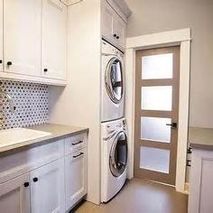 laundry rooms with stackable washer dryer - paint in sage green