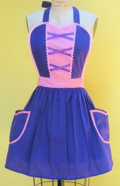 Disney Aprons. I so want this Rapunzel one!