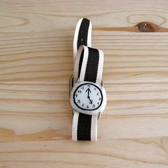 Being on time is overrated. Why not wear a wristwatch that simply makes you smile? Eva Monleón crafts hers from porcelain, fabric and leather for her Etsy shop, misako mimoko. (Also available in gingham, glitter, and metallic gold versions!)