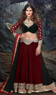 Zarine Khan Maroon Resham Work A Line Lehenga Choli Be an angel and create and establish a smashing impression on every single person by carrying this Zarine Khan maroon net and silk a line lehenga choli. The pretty embroidered, patch border, resham and zari work all through the attire is awe inspiring. Comes with matching choli and dupatta.