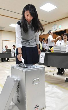 Teenage voters cast ballots as early voting began Thursday across Japan for the first national election since the minimum voting age was lowered to 18 from