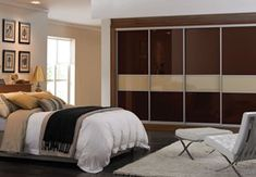 Two tone glass sliding wardrobes in chocolate and putty #coffeeandcreambedroom #fittedwardrobes #slidingwardrobes #glasswardrobes #bedroomfurniture # bedroominspiration