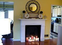 faux fireplace with candles (ACultivatedNest.Com)