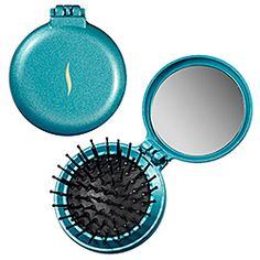What it is:A fun pop-up travel brush in a metallic turquoise color.What it does:This super-portable hair brush conveniently folds into a compact and perfectly slips into your purse or travel bag. The limited-edition sparkly, turquoise compact flips #SephoraColorWash