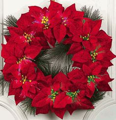 Resultados de la Búsqueda de imágenes de Google de http://www.smileyme.com/home_decor/christmas/wreaths/poinsettia_christmas_wreath.gif