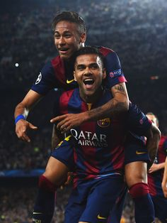 Neymar of Barcelona celebrates with Daniel Alves (front) as he scores their second goal during the UEFA Champions League Quarter Final second leg match between FC Barcelona and Paris Saint-Germain at Camp Nou on April 21, 2015 in Barcelona, Catalonia.