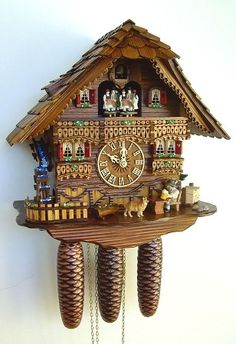 Model #8TMT 6423/9 Schneider Musical Black Forest House Cuckoo Clock, Animated Beer Drinker, Water Wheel and Dancers.