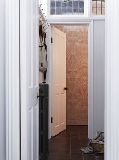 A back corner contains a utility room and wallpapered WC.