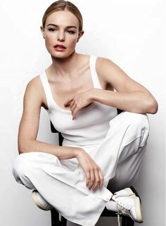 The ever gorgeous Kate Bosworth poses in a minimal white tank and simple white trousers with a sleek center part bun for an editorial in Marie Claire UK