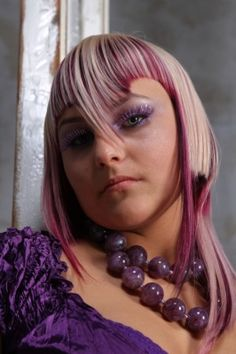 avantgarde hairstyle, pointed fringe, blond with violet hair colour