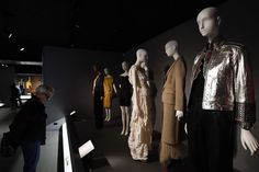 Visitors look at outfits during the Black Fashion Designers exhibition at the Museum at the Fashion Institute of Technology (FIT) in New York on February 6, 2017. Jewel SAMAD / AFP