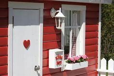 the cutest playhouse - it even has a sandbox built into the porch, I think I'd live in it