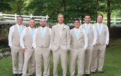 Groom and groomsmen in khaki suits and blue ties. View more from this shabby-chic Smoky Mountain wedding outdoors with sky blue and pink details at Barn Event Center of the Smokies! Formalwear via @regaltuxedoknox, pics by Lauren Blankenship Photography | The Pink Bride® www.thepinkbride.com
