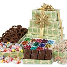 """Gift towers and baskets are also a great way to say """"thank you"""" to someone who has helped you out. Click this pin to see the various assortments this tower has to offer."""