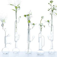 Visualize - Elise Fouin reveals a series of soliflores diverting pieces of glassware scientific borosilicate glass by students of the glass blower section of Dorian School in Paris.