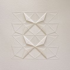 Textile designer and artist Liz Sofield loves geometry - and, evidently, it shows. This intricate paper artwork, made by using thread and simple folding techniques, was inspired by the beautiful art of Origami. Paper Cutting, Design Origami, Origami Patterns, Origami Templates, Box Templates, Paper Patterns, Doily Patterns, Art Fil, Stitching On Paper