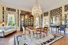The crown jewel here is the formal dining room, featuring 12-foot-tall ceilings.