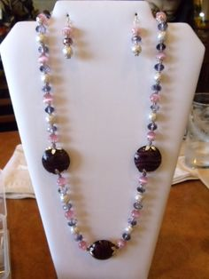 Made this piece with purple glass and crystal beads. I call it Purple Rain.