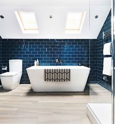 Real home: a sophisticated master suite loft conversion Loft bathroom with freestanding bath Loft Bathroom, Guest Bathrooms, Upstairs Bathrooms, Family Bathroom, Modern Bathroom, Brown Bathroom, Bathroom Suites Uk, Skylight Bathroom, Bathroom Lighting