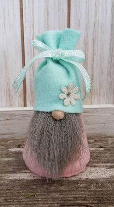 Wearing pink with a mint green hat he's ready for spring! Gnome Village, Scandinavian Gnomes, Elves And Fairies, Gnome House, Christmas Gnome, Felt Art, Holiday Ornaments, Craft Fairs, Decor Crafts