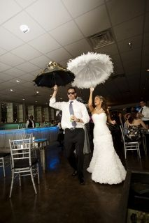 bride and groom with parasols