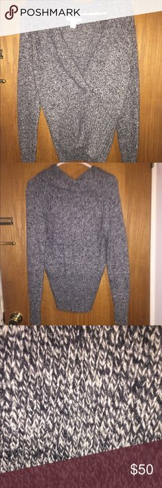 Black and white thick sweater Never worn!! Very cute low v sweater. Cute with bralette or tank top underneath! Fitted around waist and wrists! Not vegan does contain 8% rabbit hair. Very soft and comfortable! Size small fits like a medium! White House Black Market Sweaters Cowl & Turtlenecks