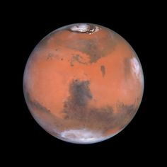 Mars, 4th planet from our sun, as seen by the Hubble Space Telescope. - http://earthsky.org/space/mars-north-south-star