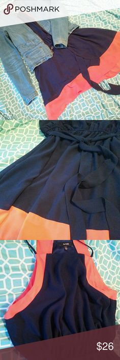 Color Pop Dress Dark navy and bright coral dress with fun neckline. Great for formal occasions with a set of heels or pair with ankle booties and a jean jacket for a more casual look.  Brand is Nu-Look. Size is a juniors Large (closer to women's 6-8). Waist is elastic and super stretchy, though and can stretch to a 10. nu-look Dresses Midi