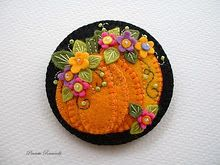 The applique work and the stitching are beautiful on this lovely pumpkin pin!