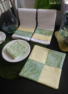 This pretty kitchen set in green and yellow will brighten any kitchen. Towels are bar mop towels with cotton material added to give your kitchen a little color. They are 16.5×18.5 inches. Hot pad is cotton and filled with insul-bright to protect your hands and countertops from