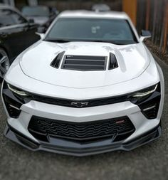 Anderson Composites carbon fiber front lip installed on 2016 Summit White Camaro SS!