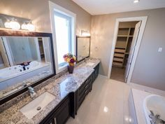Dual Vanities, Large windows, a large walk-in closet & relaxing tub. Photo by Digital Video Listings.