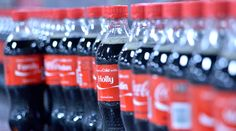 """Coke is swapping out three of its iconic logos on 20-oz. bottles for the 250 most popular first names among American teens and Millennials. """"Share a"""
