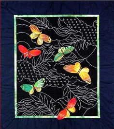 "This 22"" x 24"" wall quilt combines hand applique with traditional Japanese sashiko stitching. Available as pattern only or as a kit. The kit includes the design screened on cloth so you can follow the"