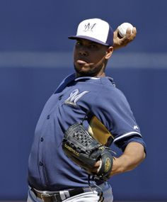 Milwaukee Brewers starting pitcher Wily Peralta throws before the second inning of a spring exhibition baseball game against the Seattle Mariners, Wednesday, March 19, 2014, in Peoria, Ariz. (AP Photo/Darron Cummings)
