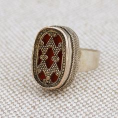 This vintage ring is from Kazakhstan. Exact age is unknown. The triangular design is symbolic of tiger claws and or fangs. Pattern is meant to protect the wearer.