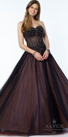 Alluring and elegant, this Dotted Tulle Lace Up Beaded Ball Gown by Alyce Paris is a show stopper that features an illusion corset bodice. #edressme