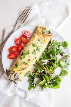 Chicken Florentine Crepes are a great savory crepe made with rotisserie chicken, mushrooms & spinach in a cheesy cream sauce.  low carb, keto, gluten free