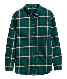 Dark green plaid flannel shirt with pearlescent buttons.   Warm in H&M