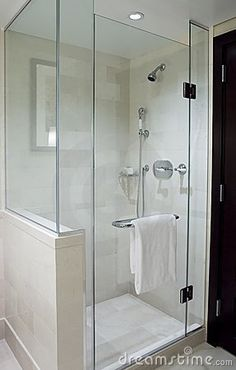 Modern stand-alone shower with glass doors