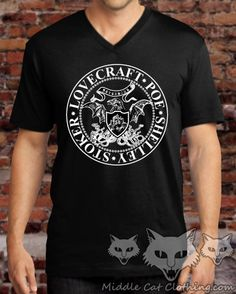 **** Now available in both V-Neck and Crew Neck! ****  These super comfy shirts feature a highly modified presidential seal with the names of some of the most influential horror writers in history: Edgar Allan Poe, H. P. Lovecraft, Mary Shelley, and Bram Stoker. Theyve all had a lasting impact on generations of readers, writers, and artists in every creative medium in our culture.  A few ladies tank tops were also printed...If youre interested in those, message me and Ill see whats left…