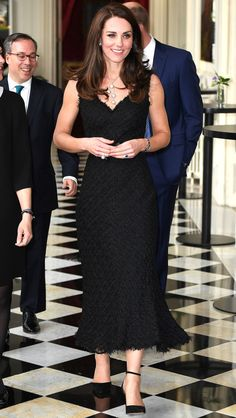 Kate is wearing a black Alexander McQueen midi dress with a trumpet flare. Classy and elegant as always! I love the texture on this dress!