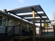 combination solid / clear patio cover using clear glass panels. Note that existing house'roof is too low, so cover is installed above it.