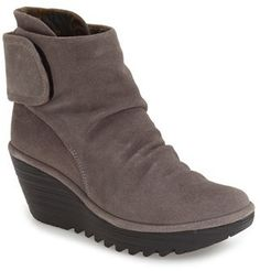 A slightly slouchy vamp and an adjustable shaft make this generously cushioned bootie comfortable day and night. A grippy platform wedge provides added traction in inclement weather. Color(s): ash oil suede, black oil suede, camel oil suede, wine oil suede. Brand: FLY LONDON. Style Name:Fly London 'Yegi' Slouchy Platform Wedge Bootie (Women). Style Number: 5185013. Available in stores.