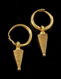Pair of gold earrings with a bow and a pendant in form of a cone with small granulate pearls. Egypt, Ptolemaic, 332 - 30 B.C.