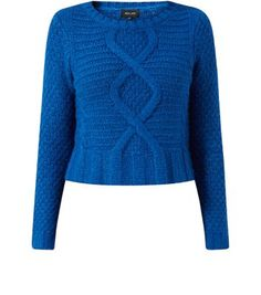 "Work this cropped knitted jumper into an autumn wardrobe - pair with dark blue skinny jeans and black heeled ankle boots to finish.- Soft knitted fabric- Cable knit design- Simple long sleeves- Cropped design- Casual fit- Model is 5'8""/176cm and wears UK 10/EU 38/US 6"