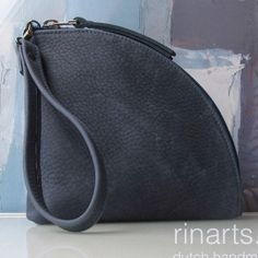 Q-bag clutch in denim blue leather