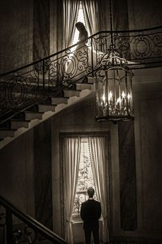 Susan Stripling  shares her work as one of the world's best wedding photographers. Here a bride descends the stairs where her groom awaits. Inspiring photography.  Click for more images from the world's best wedding photographers.
