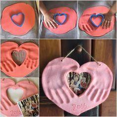 Foto Herz mit Handabdrücken